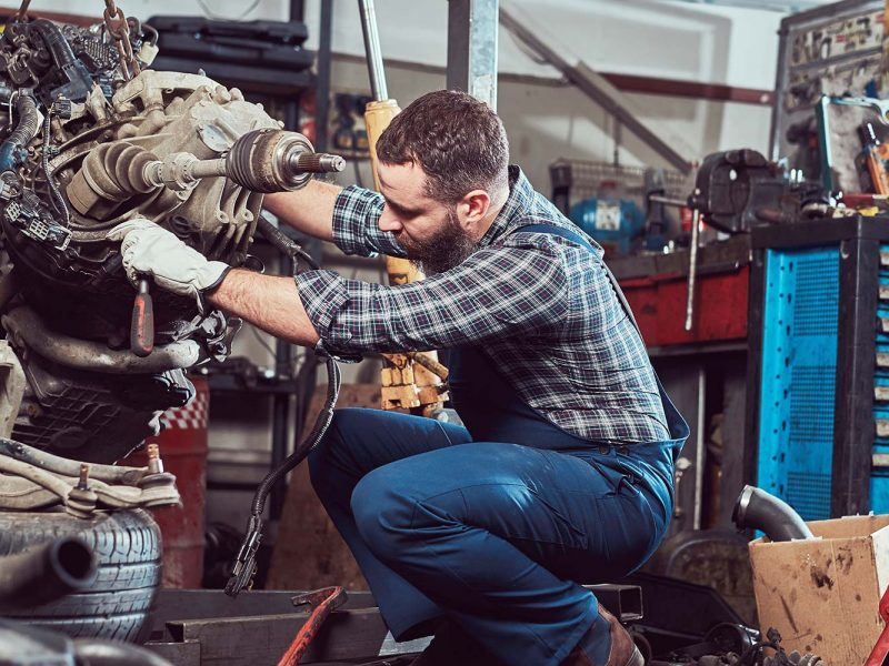 brutal-tattooed-mechanic-repairs-the-car-engine-in-small