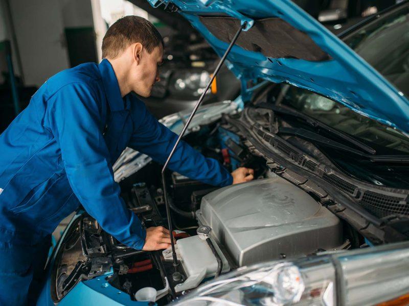 mechanic-repairs-car-engine-motor-diagnostic-small