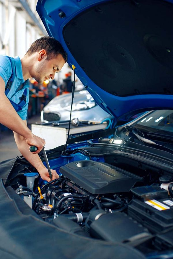 worker-in-uniform-checks-engine-car-service-small